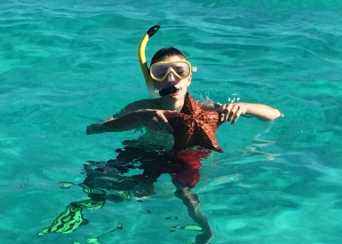 Owen and starfish: Tobago Cays